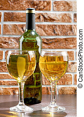 Wineglass and wall - Wine bottle and glass on brick wall...