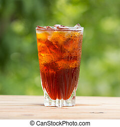 glass of ice tea  - Glass of ice tea on a wooden table