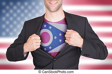 Businessman opening suit to reveal shirt with state flag...