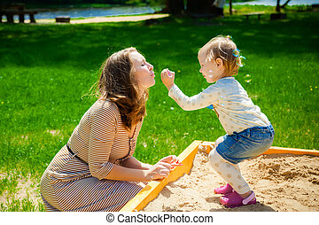 mother and daughter blowing soup bubbles