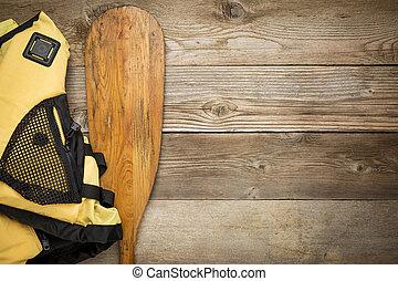 canoe paddle and life jacket