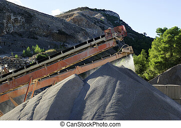 gravel pit operation that produces sand and gravel for...