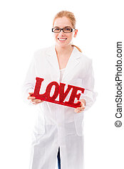 "Female scientist holding a red ""Love"" text - Young adult..."