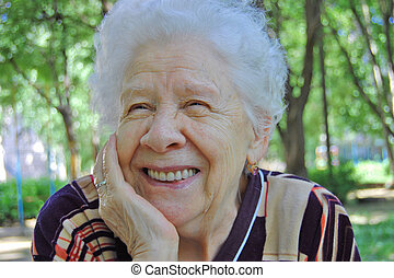 Portrait of the old woman on a green background