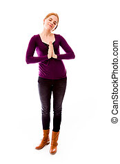 Young woman standing in prayer position - Young adult...