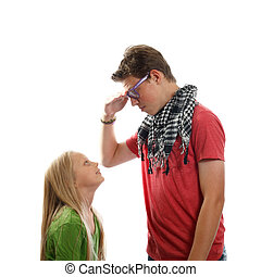teen boy and a young girl - a teen boy talking with a young...