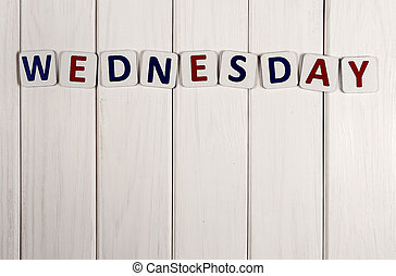 Wednesday - Inscription on Wednesday against a white wood...