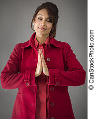 Indian young woman standing in prayer position - Adult...
