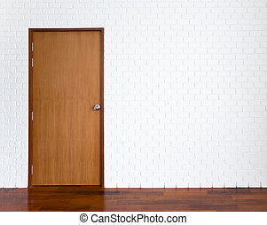 White brick wall with wooden door