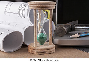 Green Hourglass - Architectural plans rolled with silver...