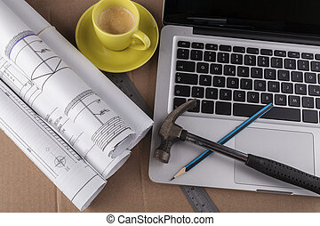 Blue Prints Rolls - Architectural plans rolled with silver...