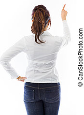 Rear view of an Indian young woman pretending to working on virtual screen
