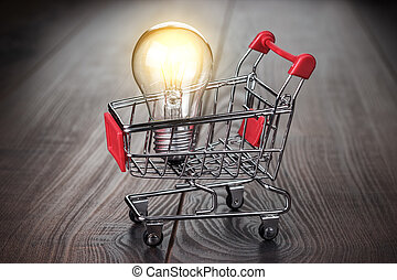 buy smart concept on the wooden background shopping trolley