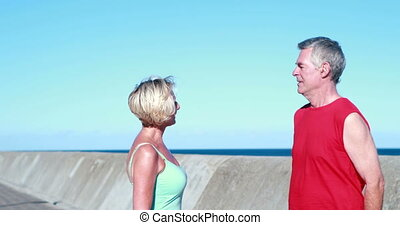 Fit senior couple chatting on a bre