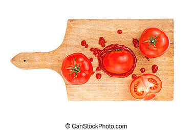 Tomato and ketchup with tomato slices on wooden board