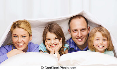 happy family with two kids under blanket at home - family,...