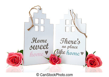 Home sweet home - White miniature house with rose and home...