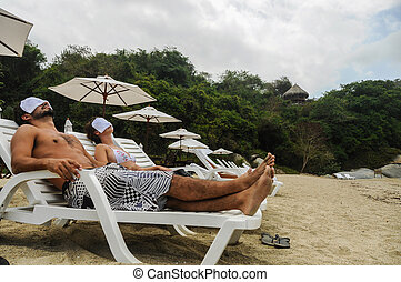 Couple Relaxing at SPA, Tayrona Beach Colombia South America...