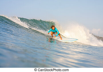 Surfing a Wave - Picture of the Surfer in the OceanLombok...