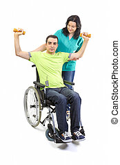 Therapist assists patient with weightlifting