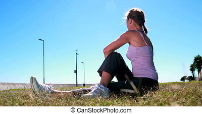 Active woman stretching before her