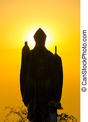 Pope Statue Silhouette - Silhouetted statue of Pope John...