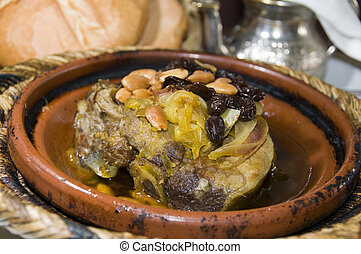 authentic moroccan lamb tagine with rasins almonds onions as...