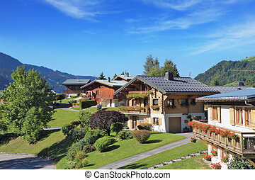 Green alpine meadows and chalets - The charming landscape in...