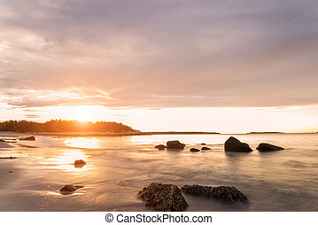 Ocean beach at sunrise - Ocean beach Crystal Crescent Beach,...