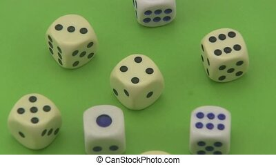 Dice on a green background. - Dice that are used in board...