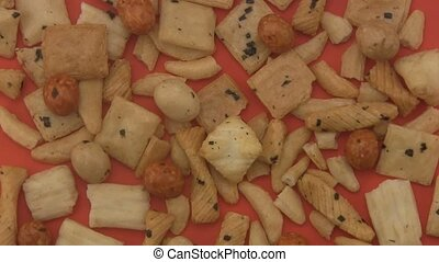 Rice crackers on a red background.