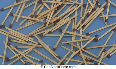 Match sticks on a blue background. - Close up of a pile of...