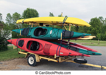 Kayaks and Trailer - Trailer full of six colorful one man...