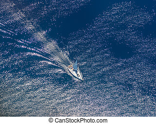 Top view of a sailing yacht at sea - Aerial view of a...