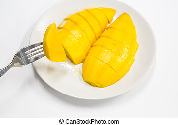 Mango on white dish