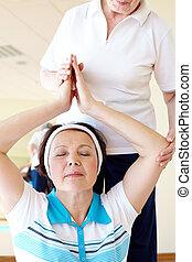 Yoga practice - Portrait of aged female doing yoga exercise...