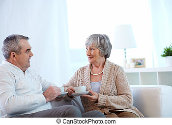 Having tea - Image of couple of pensioners drinking tea and...