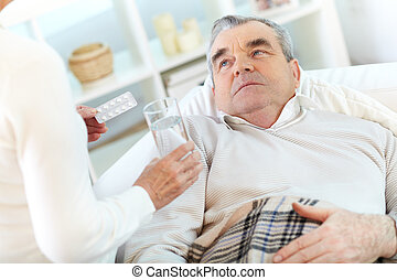 Sick man - Image of sick senior man looking at his wife...