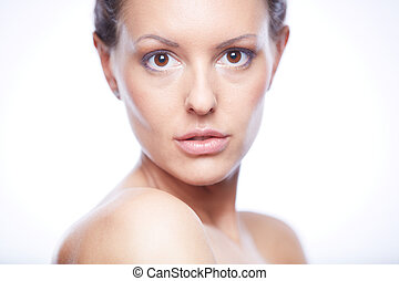 Calm female - Face of pretty woman looking at camera in...