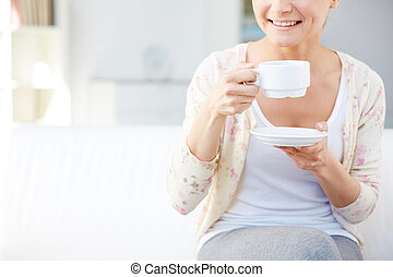 Drinking tea - Image of young smiling woman drinking tea