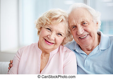 Lovely seniors - Portrait of charming seniors enjoying...