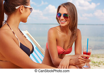 Girls resting - Two young girls enjoying rest on the beach