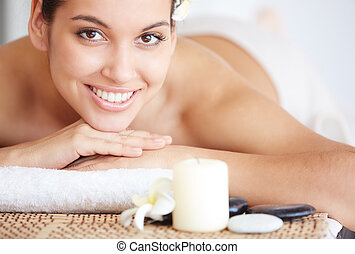 Spa beauty - Portrait of happy young female looking at...