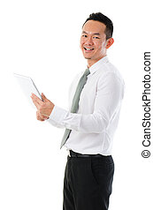 Asian business man using tablet computer isolated on white backg