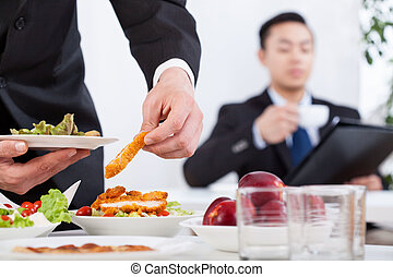 Asian men during business lunch in the office