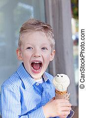 boy eating ice-cream - excited little boy eating ice-cream