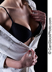 Closeup of the breasts of woman in a black bra - Closeup of...
