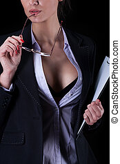 Sexy businesswoman with unbuttoned shirt holding glasses