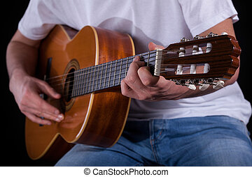 Male hands playing guitar - Close-up of a male hands playing...
