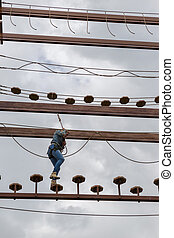 Young woman engaging an obstacle course